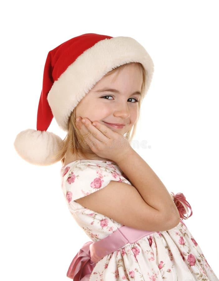 Miúdo do Natal no chapéu de Santa imagens de stock