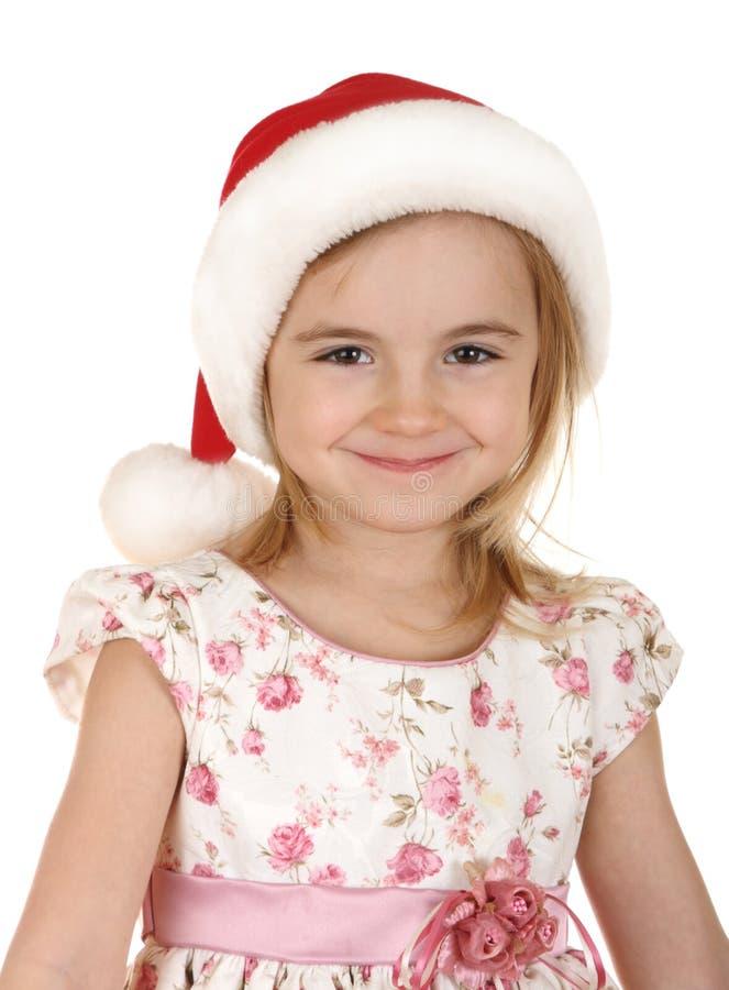 Miúdo do Natal no chapéu de Santa foto de stock royalty free