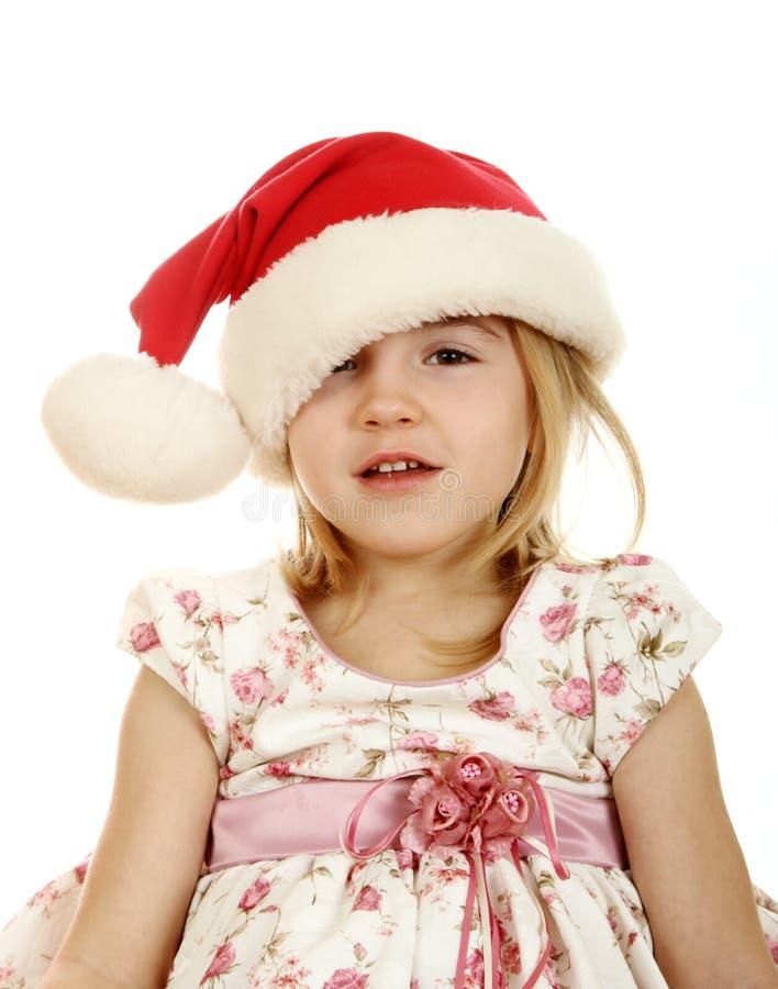 Miúdo do Natal no chapéu de Santa imagem de stock royalty free