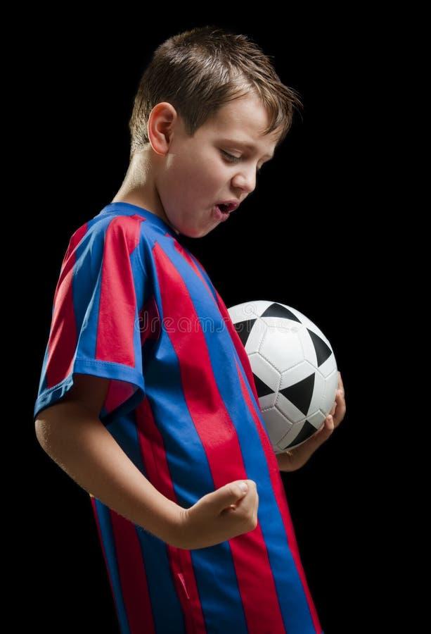 Miúdo feliz do futebol no preto imagens de stock