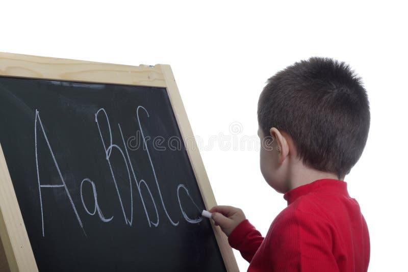 Miúdo no quadro-negro fotos de stock