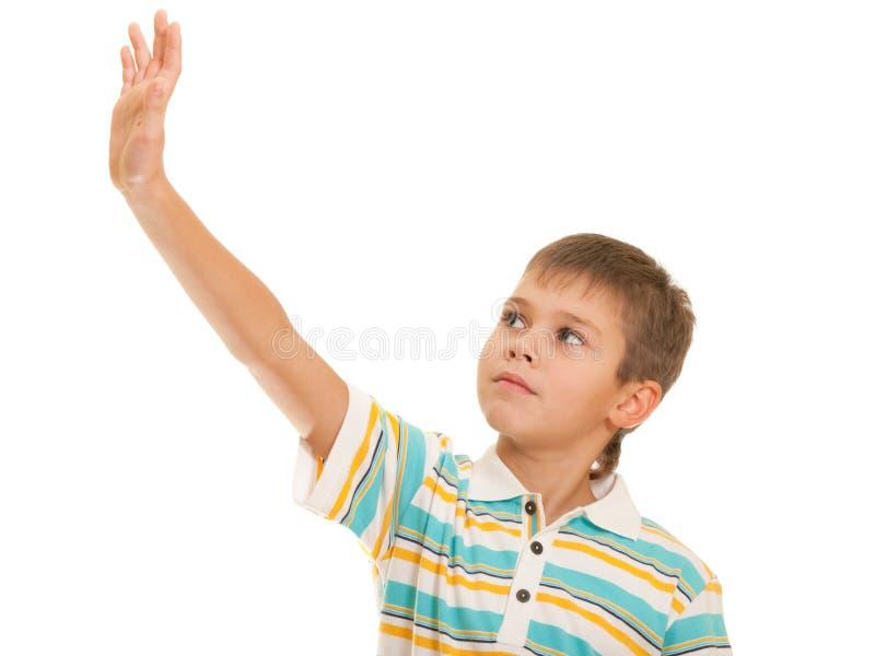 Miúdo que olha seu mão acima levantada fotos de stock
