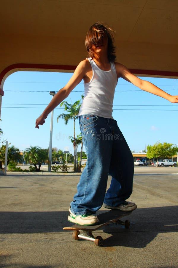 Miúdo Skateboarding imagem de stock