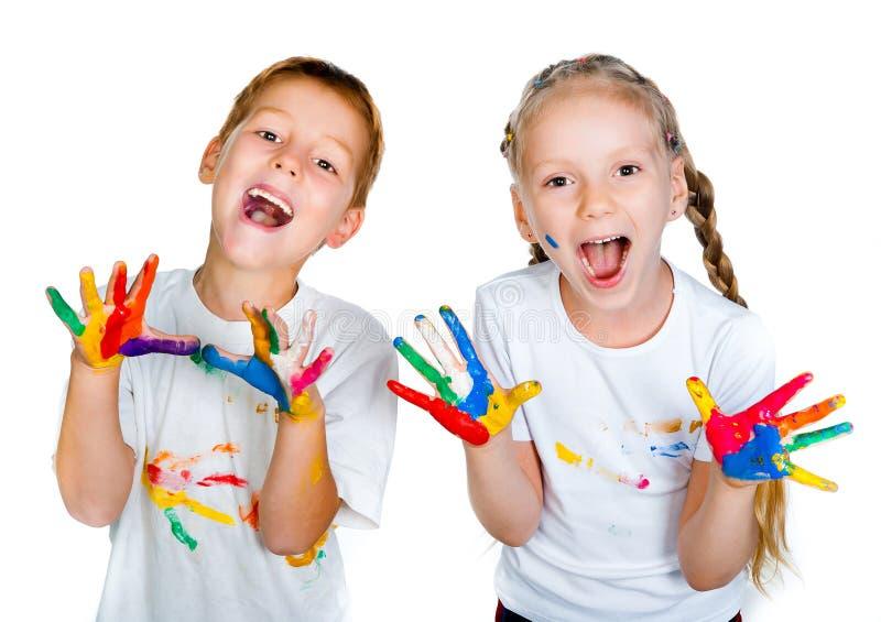 Miúdos com ââhands na pintura imagens de stock