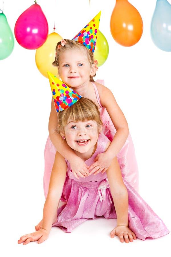 Miúdos em chapéus do partido fotos de stock