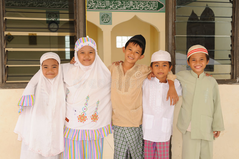Miúdos muçulmanos fotografia de stock