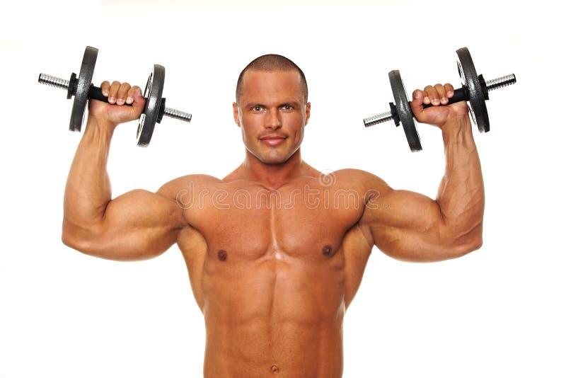 Mięśniowi mężczyzna ćwiczenia zdjęcie stock