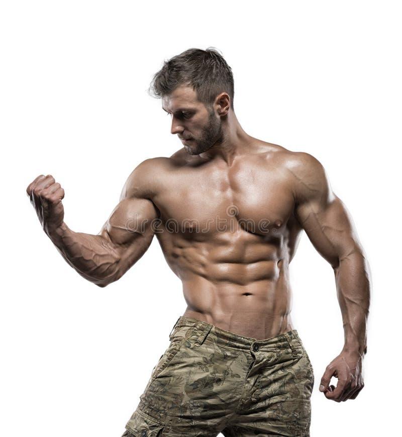 Mięśniowy bodybuilder facet odizolowywający nad białym tłem zdjęcia stock