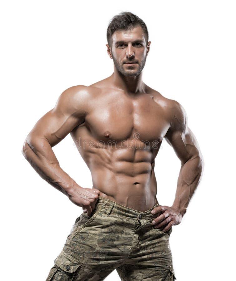 Mięśniowy bodybuilder facet odizolowywający nad białym tłem zdjęcia royalty free