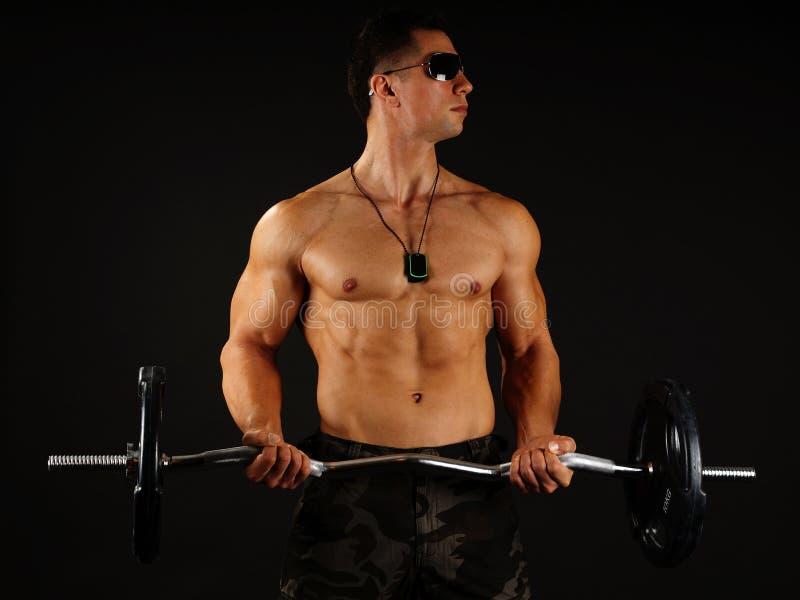 mięśniowy dumbbell mężczyzna zdjęcie royalty free
