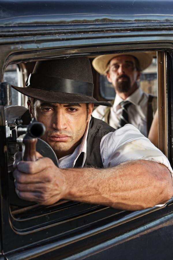 Mięśniowy Gangsterski strzelanina pistolet obrazy stock