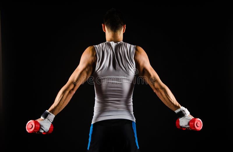 Mięśniowy mężczyzna ćwiczyć zdjęcia royalty free