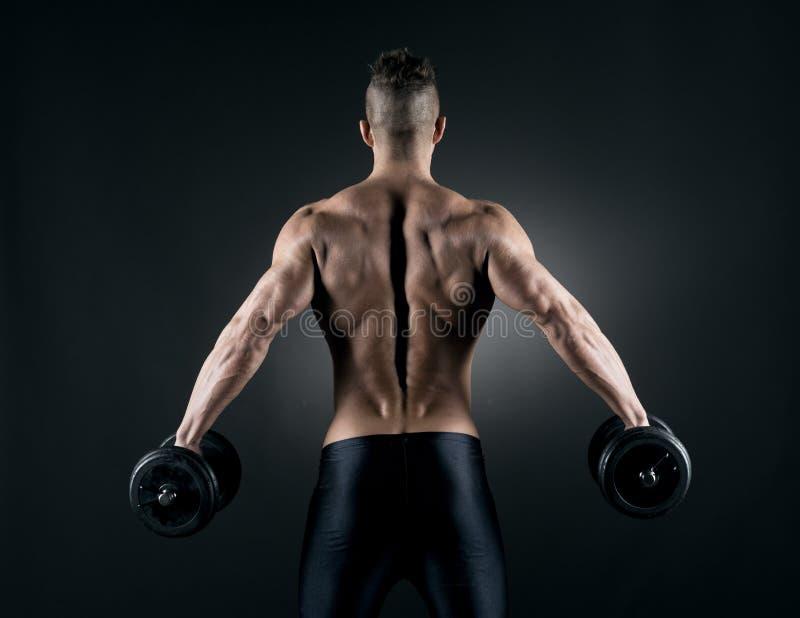 Mięśniowy mężczyzna weightlifting fotografia royalty free