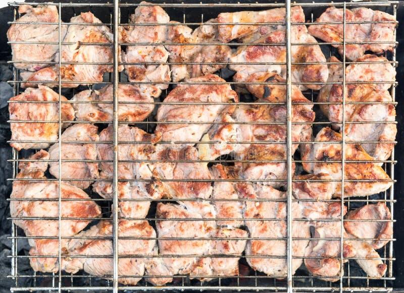 Mięso na grillu z dymem zdjęcie royalty free