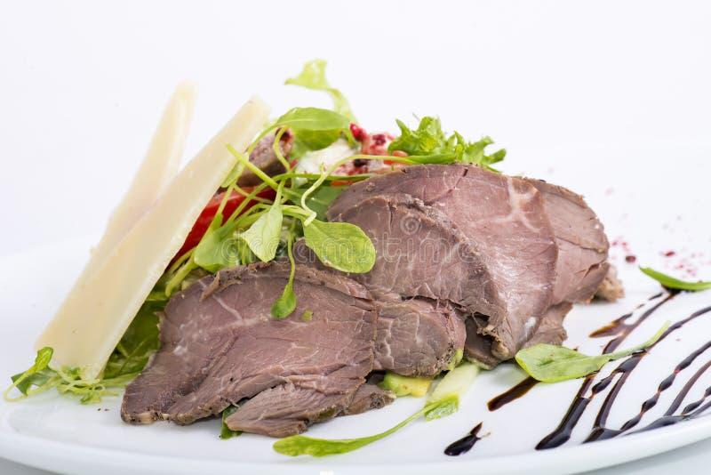 Mięso z sałatką obrazy royalty free