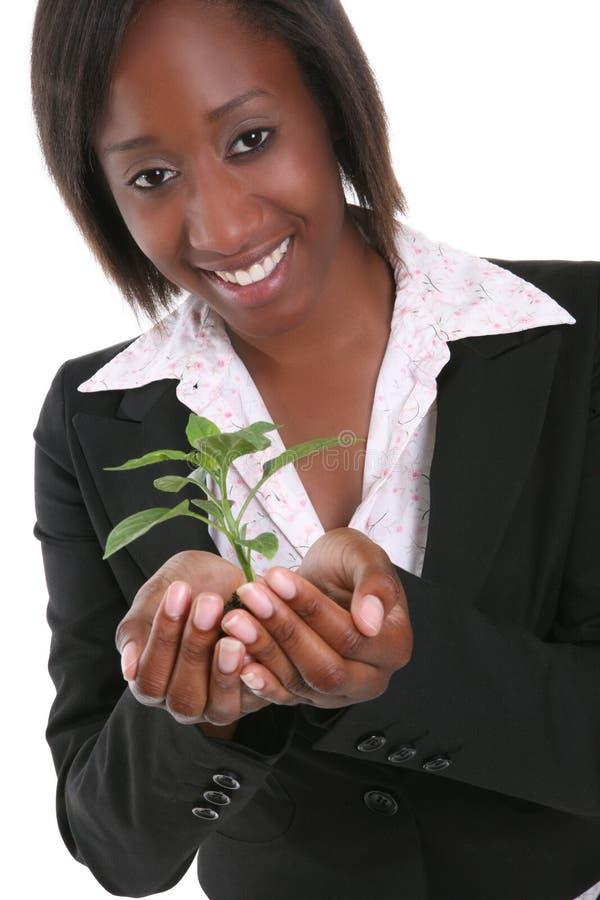 miła kobieta wzrostu roślin zdjęcie royalty free