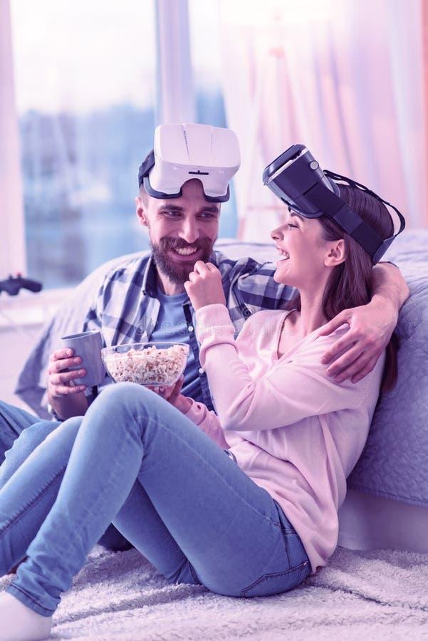 Miła męska osoba obejmuje jego ładnego partnera obraz royalty free
