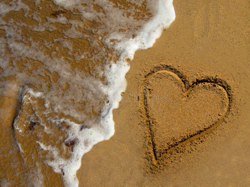 Miłość piaska morze zdjęcia stock