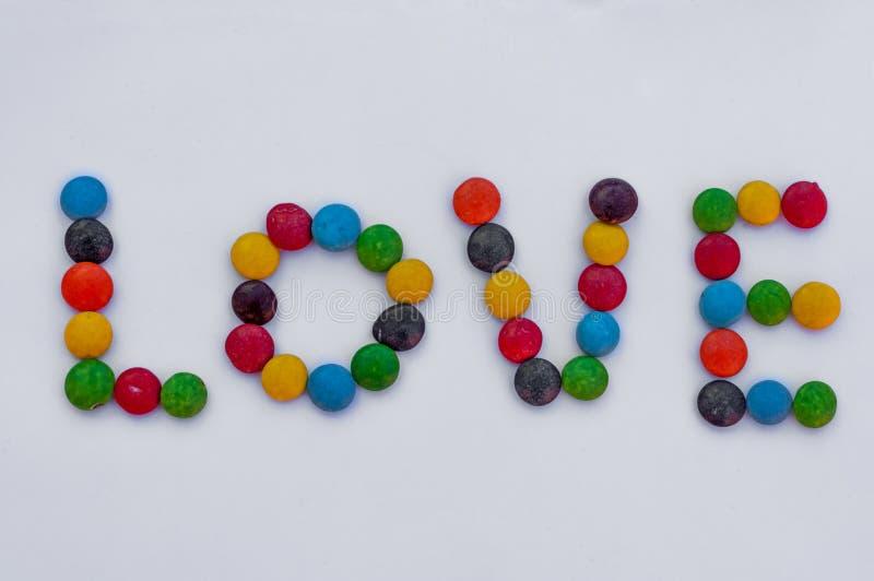 Miłość pisać cukierkiem fotografia royalty free