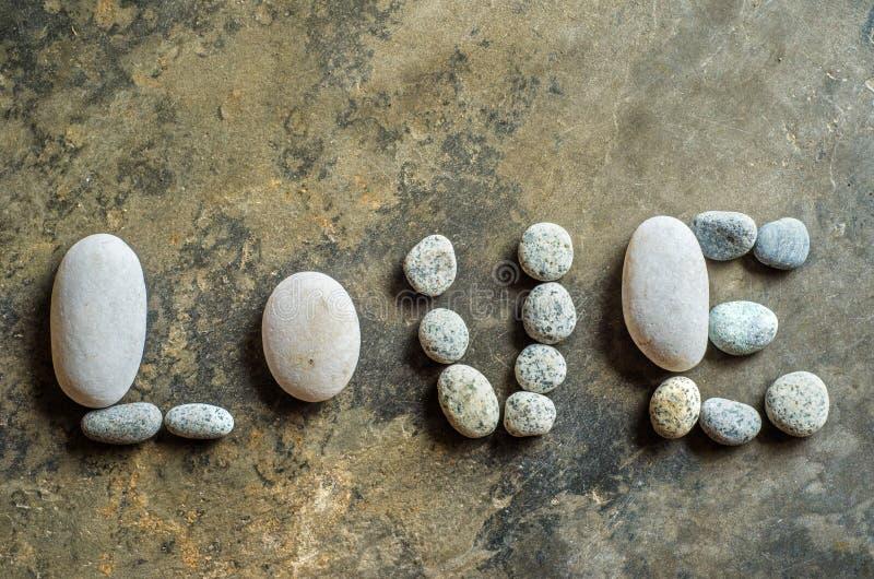 Miłość tekst od zen kamienia obraz stock