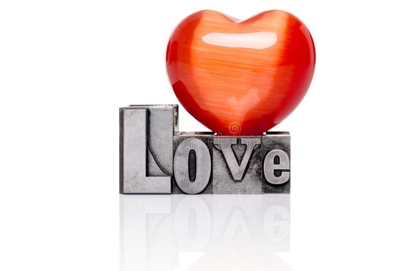 Miłość w starym metalu letterpress odizolowywającym obraz royalty free