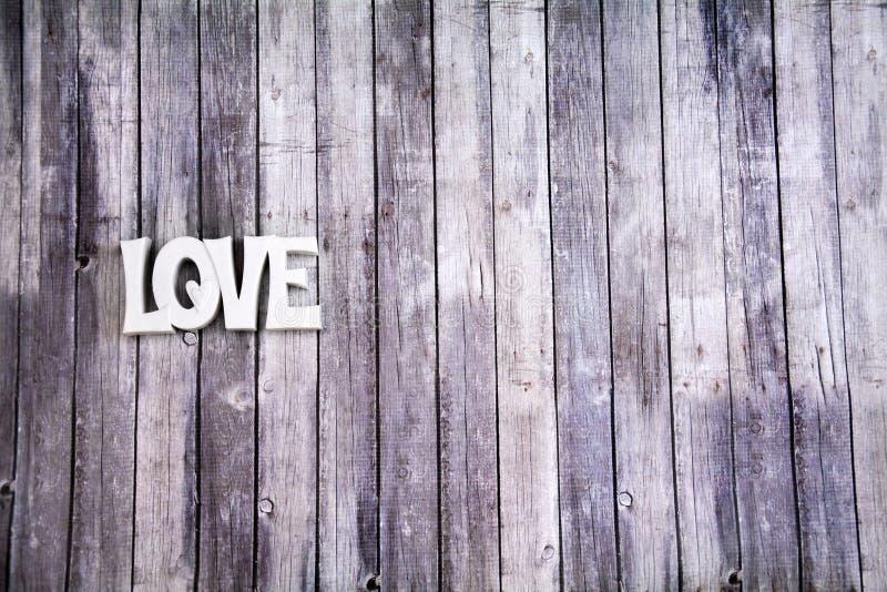 Miłość znak na drewnianej podłoga zdjęcia stock