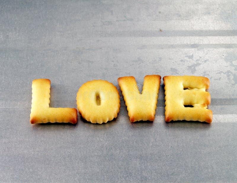 Miłości słowo, biskwitowi ciastko listy obrazy royalty free