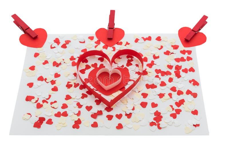 Miłości walentynki serca i czerwieni klamerki zdjęcia royalty free