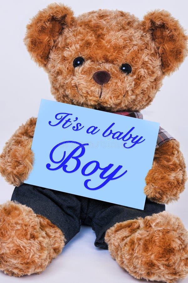 Miś trzyma błękita znaka mówi Mnie ` s chłopiec obraz royalty free