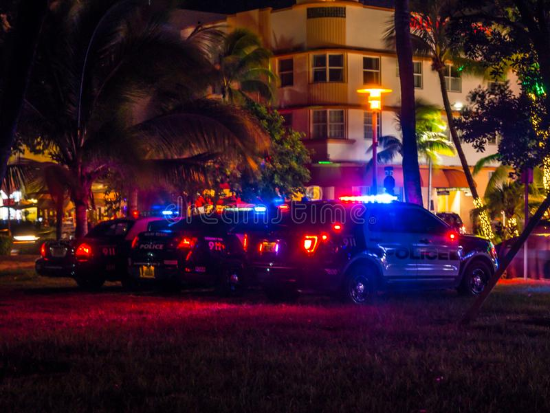 Miama, Florida, USa - August 2019. police car parks at the Ocean Drive along South Beach Miami in the historic Art Deco District. With hotels, restaurant and stock image