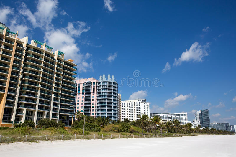 Miami Beach Condominiums Hotels. Hotels and condominiums line the white sandy Miami South Beach, Florida, USA royalty free stock image