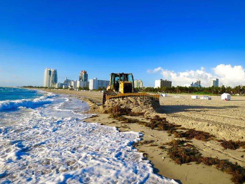 Miami beach and excavator stock photos