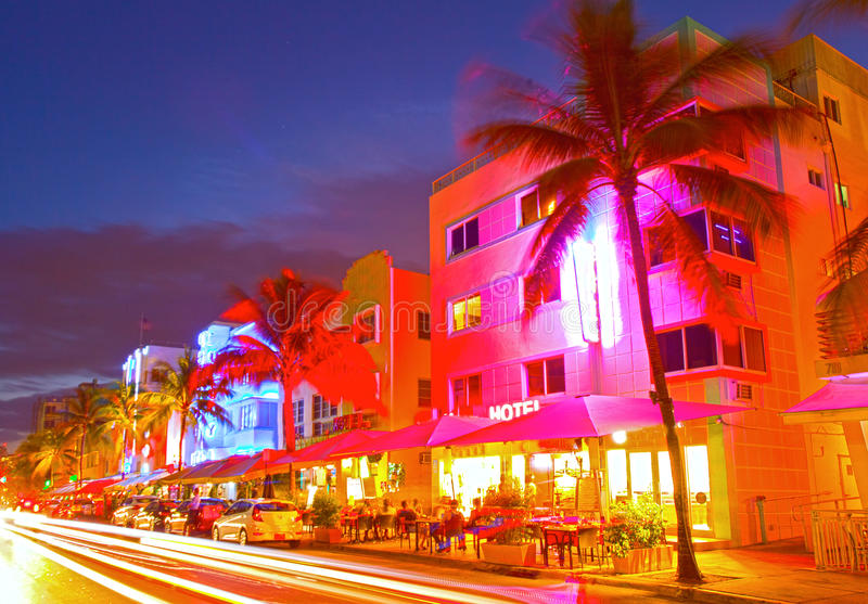 Miami Beach, Florida Moving traffic hotels and restaurants at sunset on Ocean Drive. World famous destination for it's nightlife, beautiful summer weather and royalty free stock image