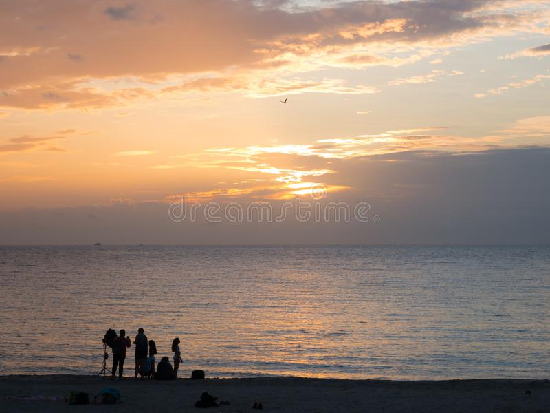 Miami beach, Florida, USA. August 2019. People relaxing during the sunset in South Beach. South Beach is famous for its tropical. Sea, the long white beaches royalty free stock photography