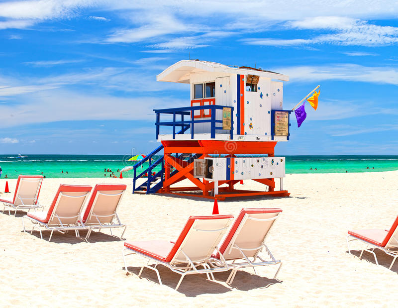 Miami Beach Florida, USA famous tropical travel location. Typical Art Deco lifeguard house on a beautiful summer day with ocean and blue sky stock photo
