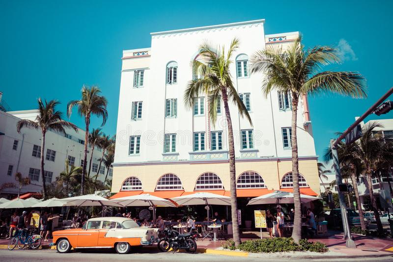 MIAMI BEACH, FLORIDA, USA - FEBRUARY 18, 2018: Vintage Car Parked along Ocean Drive in the Famous Art Deco District in South royalty free stock photography