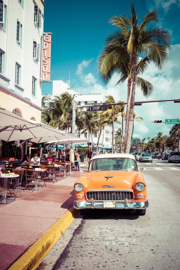 MIAMI BEACH, FLORIDA, USA - FEBRUARY 18, 2018: Vintage Car Parked along Ocean Drive in the Famous Art Deco District in South stock photo