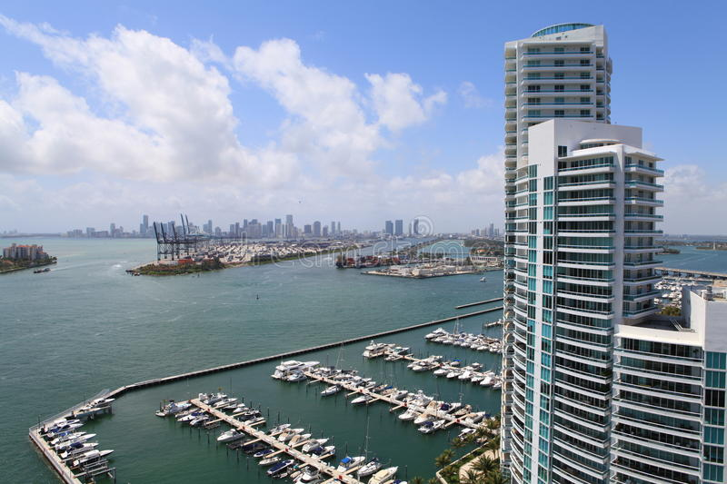 Miami Beach Marina and highrise. Aerial view of Miami beach Marina and the Murano building with Port of Miami and Downtown Miami in the background royalty free stock photo