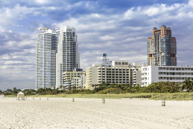 Miami beach with skyscrapers stock photos