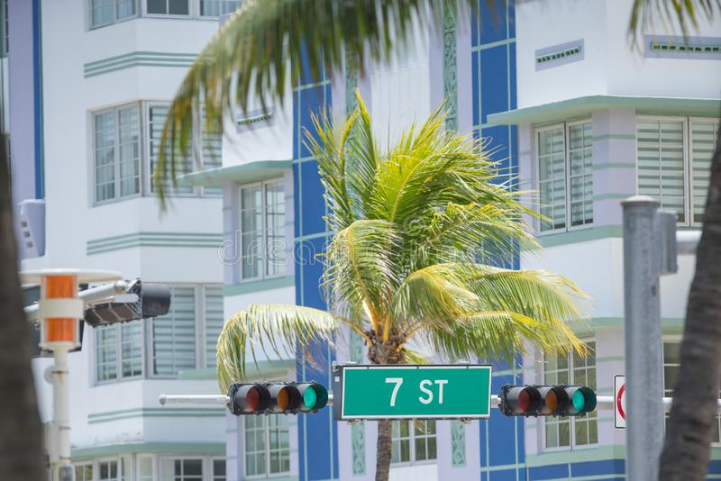 Miami Beach 7th Street road sign with palm trees and hotels in background. USA stock image