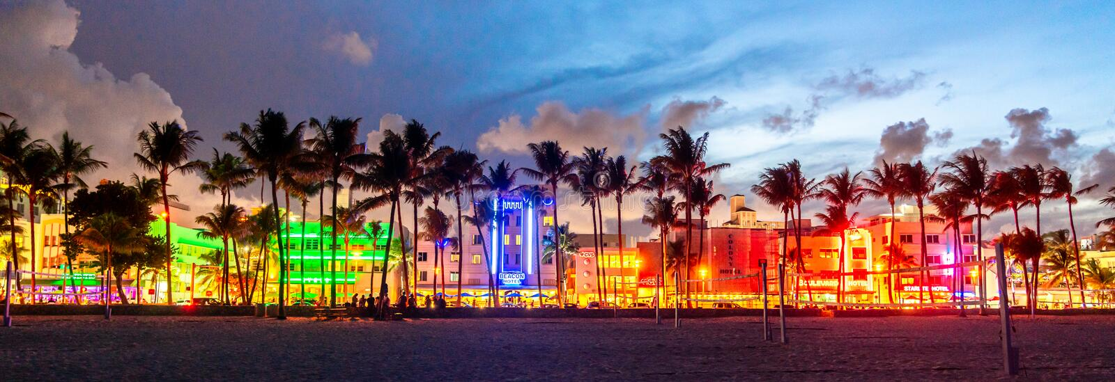 Miami Beach, USA - September 10, 2019: Panorama of Ocean Drive hotels and restaurants at sunset. City skyline with palm stock photography