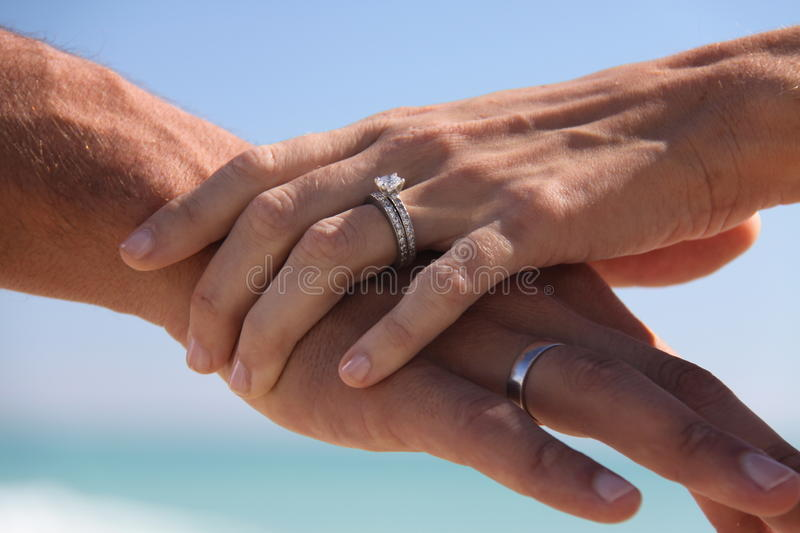 Miami Beach Wedding Rings 2. Couple holding hands on the beach with wedding rings royalty free stock photos