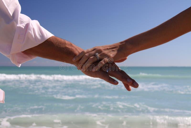 Miami Beach Wedding Rings and arms royalty free stock photos