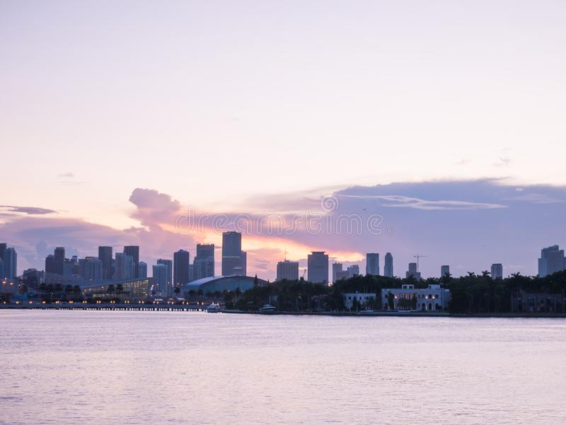 Miami city skyline panorama at dusk with urban skyscrapers and bridge over sea with reflection.  stock image