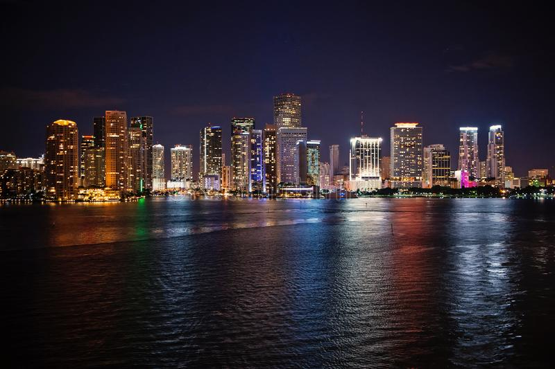 Miami city skyline panorama at night, usa. Skyscrapers illumination reflect on sea water in dusk. Architecture. Mi city skyline panorama at night, usa stock photos