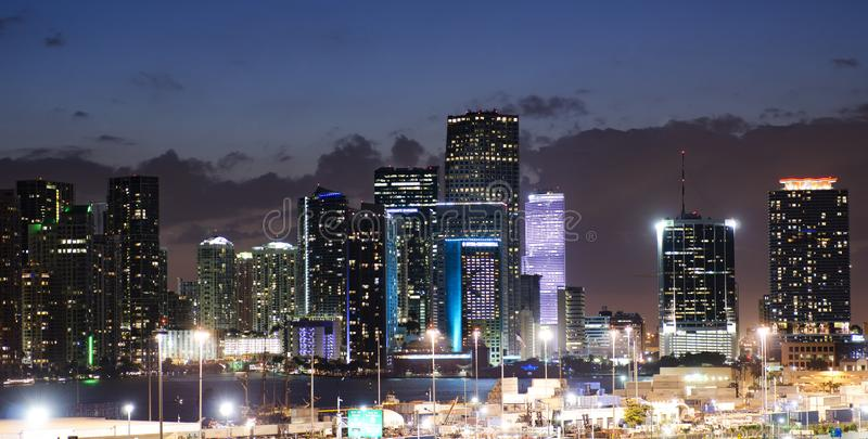 Miami Florida downtown at night. Miami Florida downtown illuminated business and luxury residential buildings and hotels at night royalty free stock images