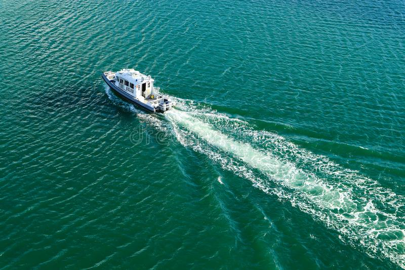 Aerial View of Miami-Dade Harbor Police Vessel. MIAMI, FLORIDA/USA - NOVEMBER 10, 2019:  Aerial view of Miami-Dade Harbor Police vessel stock images