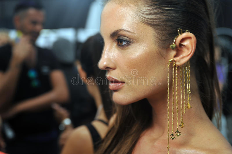 MIAMI - JULY 19: Model gets ready backstage at the Agua Bendita Collection for Spring/ Summer 2014. During Mercedes-Benz Swim Fashion Week on July 19, 2013 in stock photography