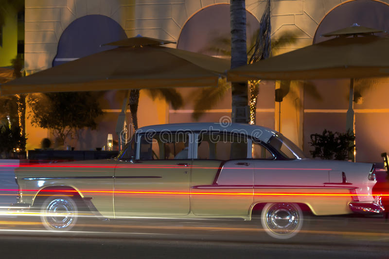 Miami ocean drive night. Classic car standing in a parking lot of the Ocean drive of Miami beach royalty free stock photos