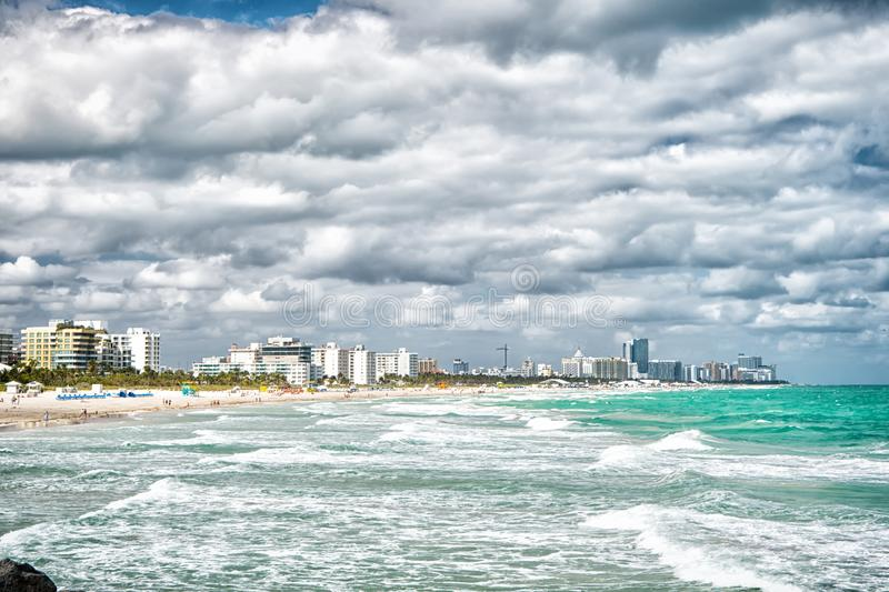 Miami south beach. Skyline with skyscrapers on cloudy day. Florida travel. What to do at Miami beach. Seashore waves royalty free stock images
